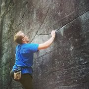 John tries the project on the five star boulder