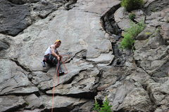 Rock Climbing Photo: Climber setting up belay at P1 anchors.