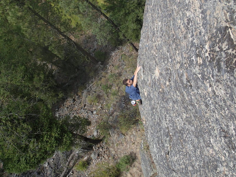 climber on the upper face of Opti-mystic