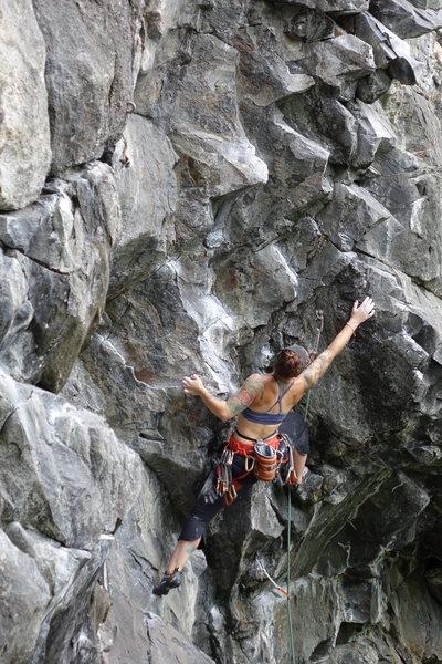 Reaching for beta - climber, Samuelle W.