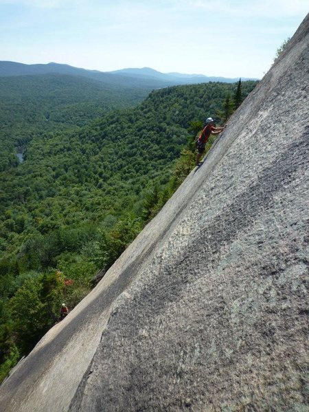 Looking across to a climber on P3.  Steep!