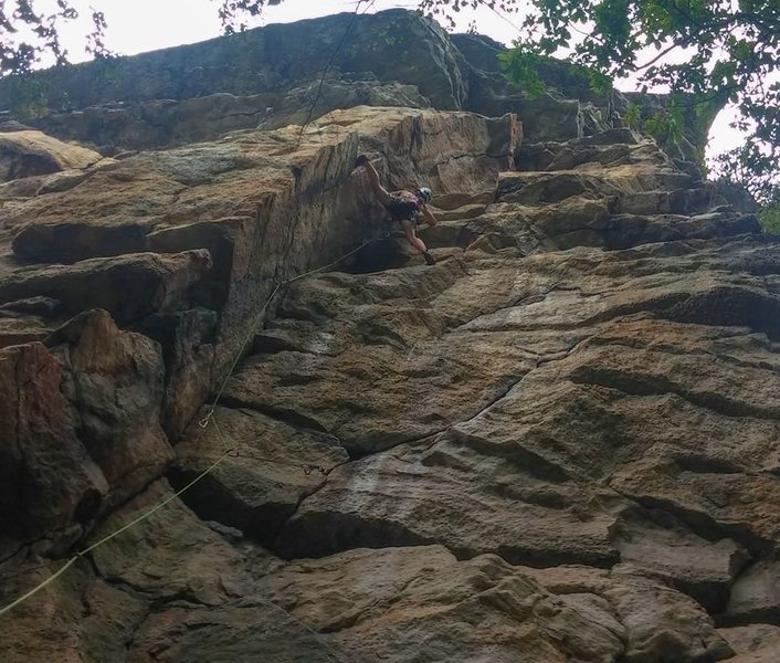 A few moves above the crux (where the face bulges out). The climbing eases from here.