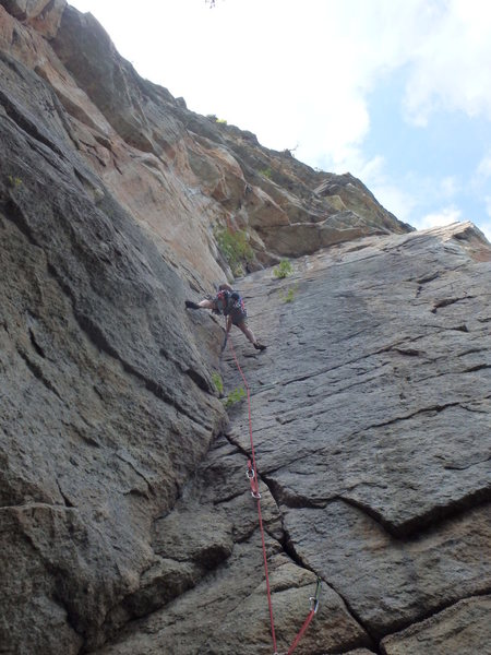 The corner on the first pitch makes for fine bridging.  Climber: John Hoffman, Photo: J Ely.
