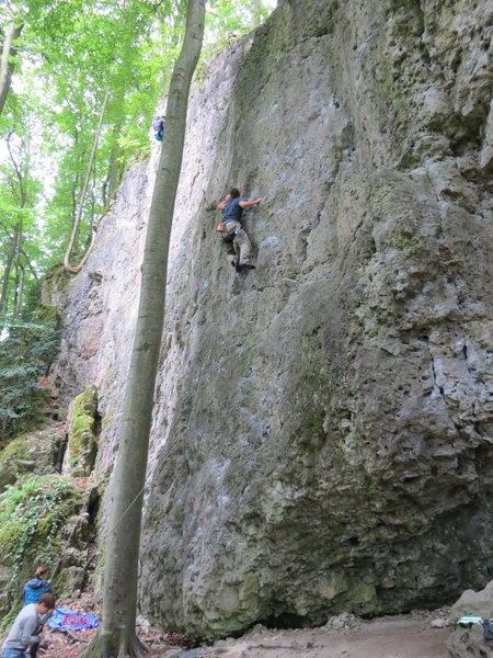 A Polish climber struggling with the crux moves.