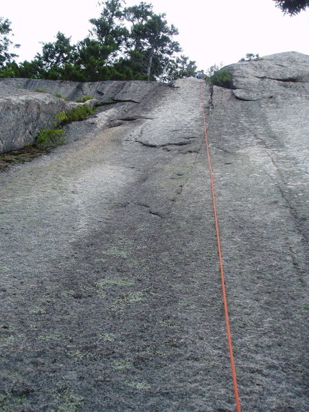 "Catch 22 - climbs the dike-seam to the right of the route, Var 1 climbs the white slab to the left of the route. ""Var 3"" the right-facing inside-corner is to the far left with vegitation"