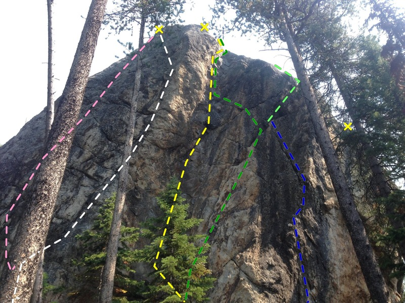 West side:<br> Blue = 5.12+ Kehough: flexi flake, small holds prow, classic. Cam directional. Start off patio.<br> Green = 5.11 Crack: distinct crux at 6m. finish in flare right with cam directional or left to &quot;Black Dike&quot;. <br> Yellow = 5.10d/11a Black Dike: Classic crimps up dark colored dike. &quot;Best 5.10 in the Tetons&quot;, 3 bolt anchor <br> White = 5.12-: Arete': Classic prow, squat, crimp and arete rail, bolt anchor. 2 old bolt, 1 newer. <br> Pink = 5.11: NW face, start arete or flexflake, hidden crimp 3/4 height, not as classic as Arete'... <br>