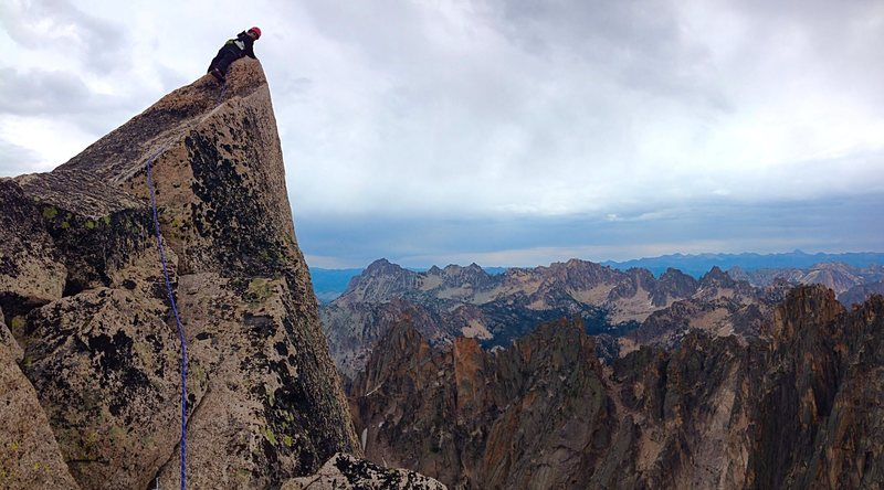 Rock Climbing Photo: Catie peeking over the VERY exposed summit pinnacl...