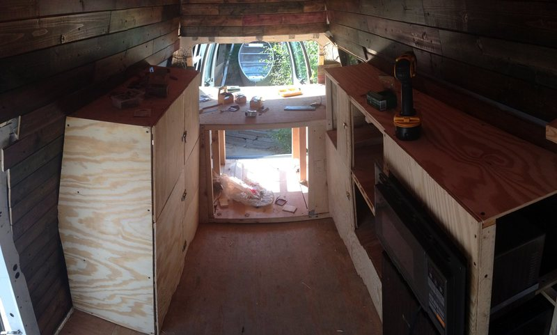 Working on the interior so I can get set off. Had this van last season with it fully decked out by the previous owner. However the sink and shower took up to much space i needed for gear so why not just rip the whole van apart and start rom scratch? So far walls are insulated and covered with wood panels i stained, high raised bed to fit all the gear plus more, shelving for closet use and kitchen. Soon to be an expandable bench and a wood stove in the left corner for ski season. Anticipation is killing me to get out on the road...can't wait to get finished.
