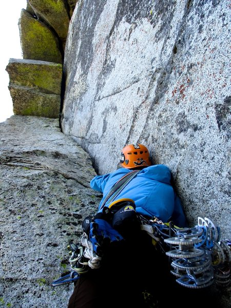 Rock Climbing Photo: Dow starting up the offwidth at the start of Pitch...