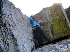 Rock Climbing Photo: Dow making the wild move left at the roof on Pitch...