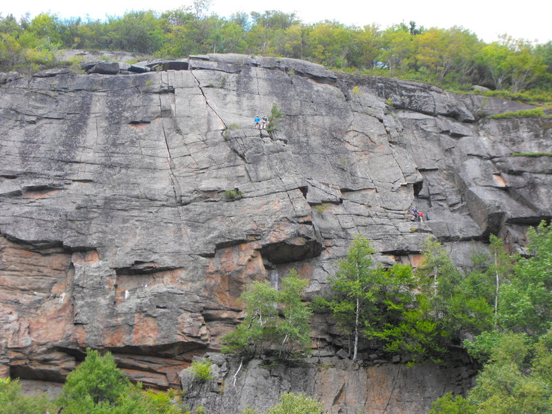 Climbers at both first and second belay points (how convenient for illustrative purposes!),starting the second then final pitch. The starting base can't be seen in this pic but I think it is slightly right of  climbers, about 50 ft down, behind the tree line. ...<br>  Aug 2015