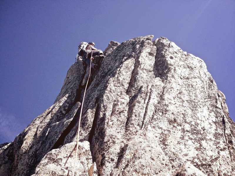 Michael leading a 5.8 flake direct variation on the summit pinnacle. So much better than scrambling up loose rock!