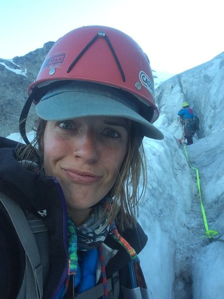 sitting in a protective crevasse at the top of our last long rappel down Mt Ulysses on the Skillet Glacier in the Selkirks