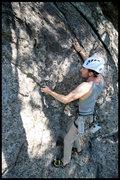 Rock Climbing Photo: Tyler approaching the fun mantle move.