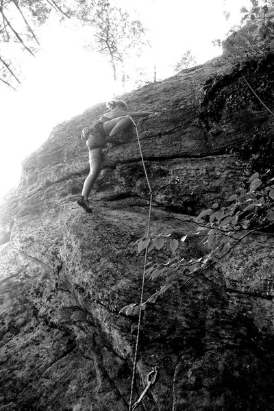Rock Climbing Photo: Torie demonstrates the high step crux of the route...