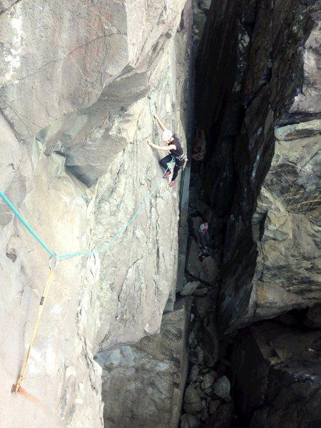 Morgan traversing left towards the second bolt.