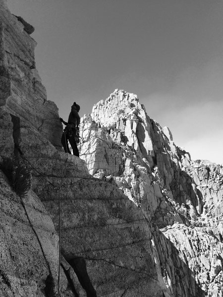 Chris Orozco leading the final pitch on Tulainyo Tower with Mt Carl Heller in the background
