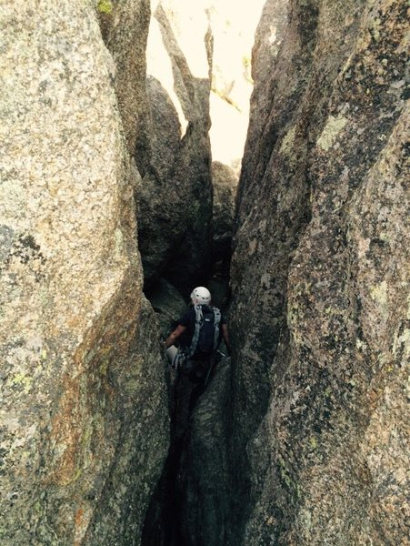 Climb down this slot to get from the top of Pin Route to the descent down Bowels of the Owls.