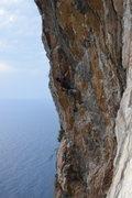 Climbing along the coast in Italy