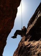Rock Climbing Photo: Rappelling down black corridor