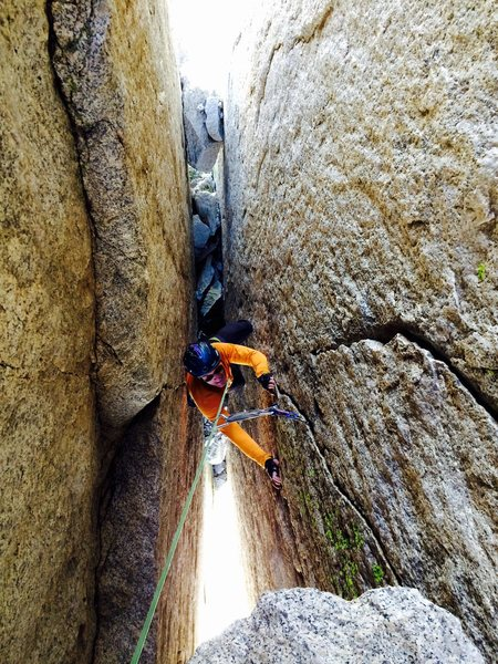 Peter Pribik following the chimney/finger crack pitch low on route.