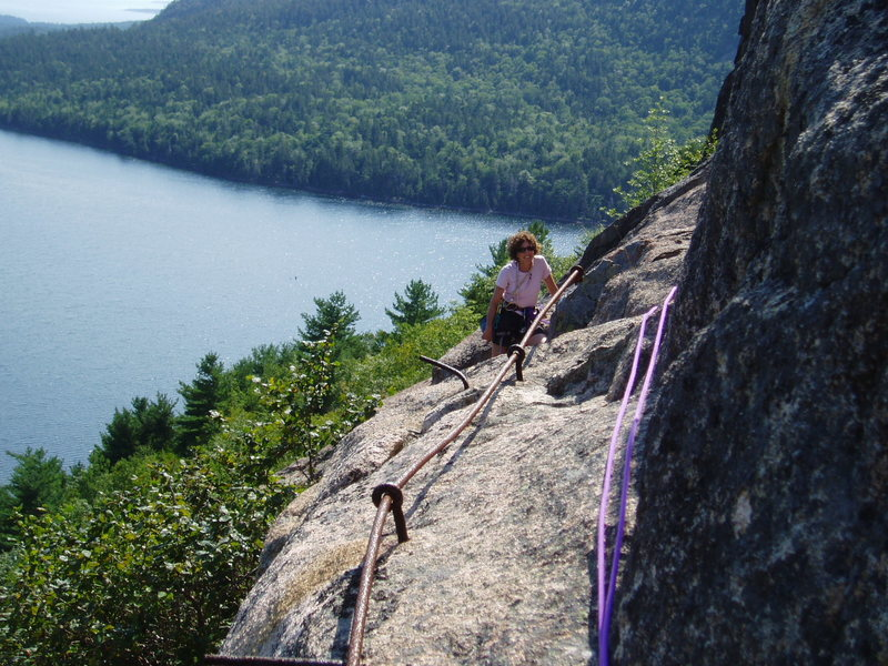 """S Matz about 2/3rds of the way along the Via Ferrata; much of the Ferrata has less """"hardware"""" than shown here. Jordan Pond in the background"""