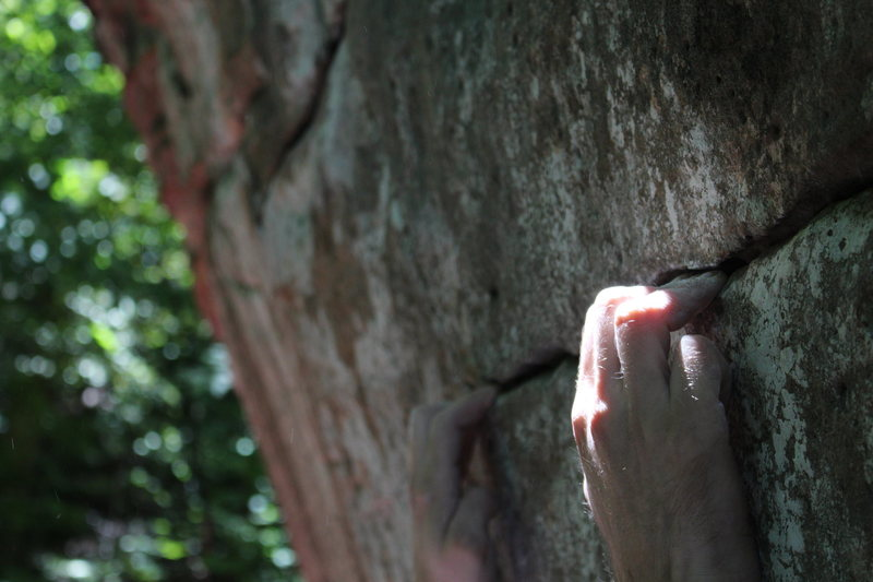 The thin, crimpy starting holds of Cross and Toss