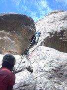 The base of Inspiration, pulling the direct start on the arete makes it bit more challenging and fun