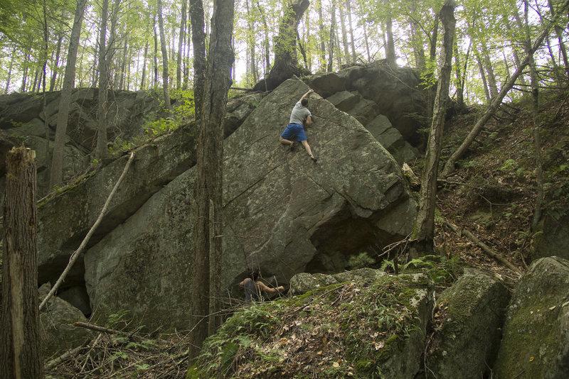 Rock Climbing Photo: Ryan MacGlaflin topping out the boulder.