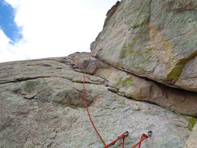 looking up at the recommended left exit for the 4th pitch. Hardest moves are right of the belay (5.8?) and then it eases up.