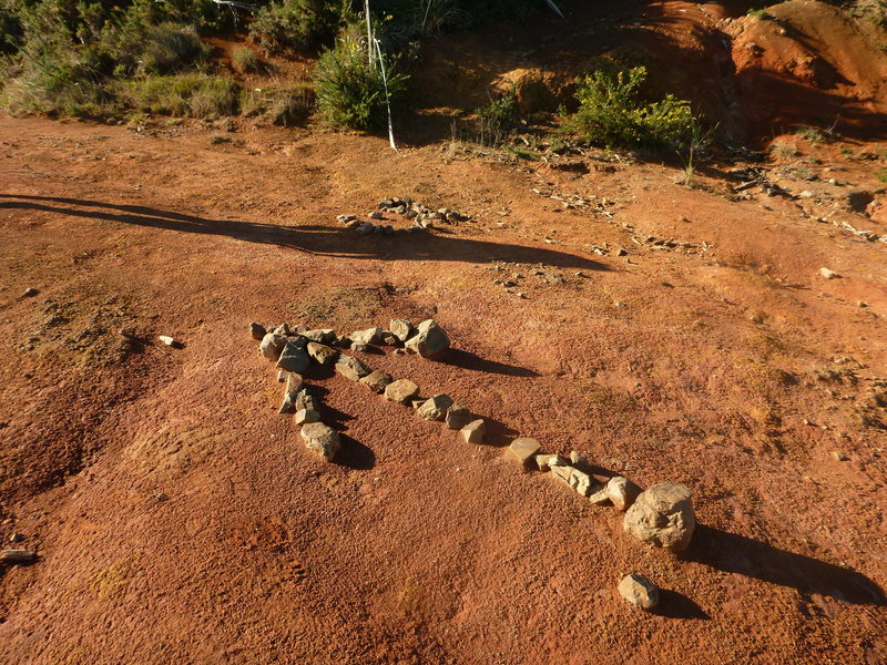 Rock Climbing Photo: The stone arrow marking the start of the track