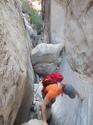 Rock Climbing Photo: Coming up the slot canyon. There are fixed lines a...
