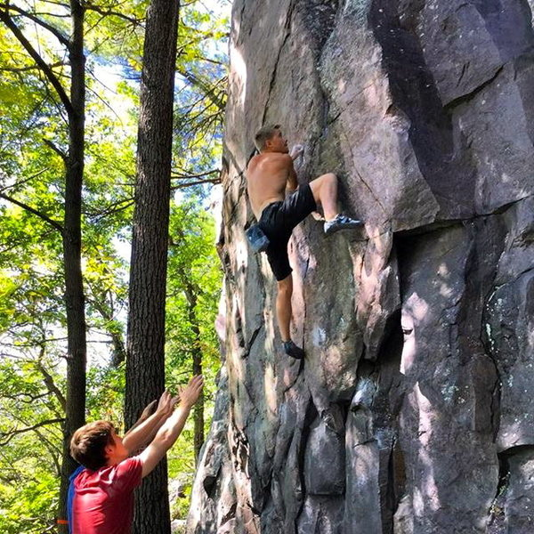 Rock Climbing Photo: Up high on the problem. Don't fall from here on up...