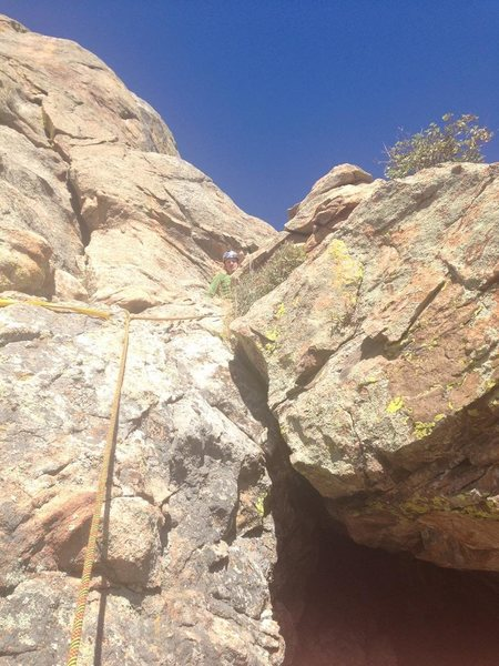Looking up to second belay. You can belay on ledge where anchor in picture is or move and have a nice sitting belay.