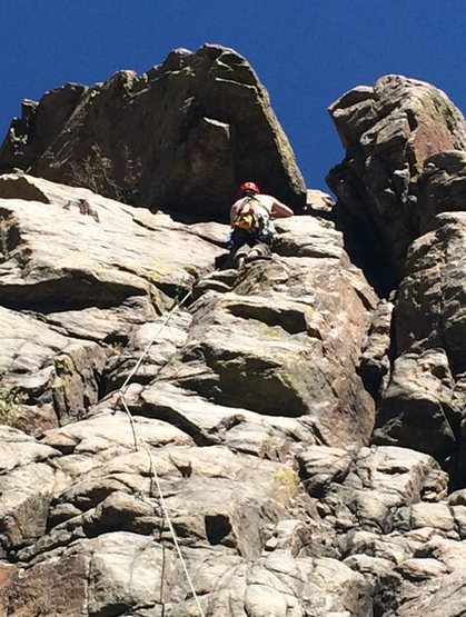 warming up on an easy trad route on the sports wall in clear creek.