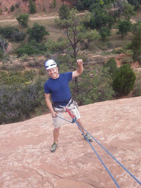 Fist pump before abseil from The Good Stuff at Red Rocks Canyon.