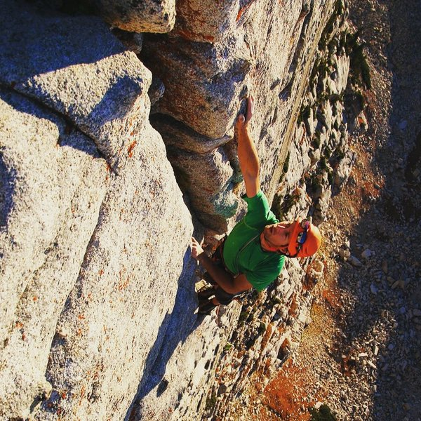 Josh Beckner topping out the Lowe Route on the Question Mark Wall.