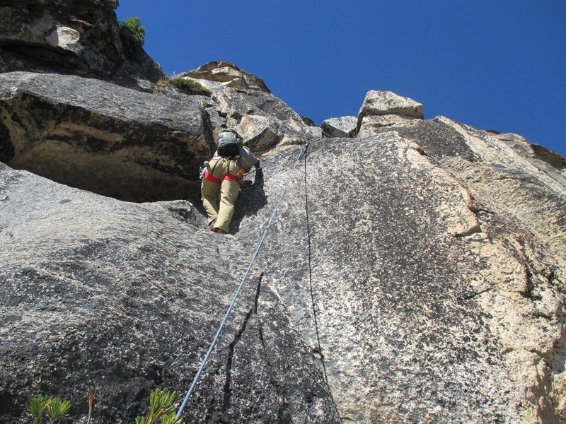 """Erik Leidecker and I following Erica Engle's lead. This is the """"1st Crux"""" in Ian's guidebook. There are multiple variations possible. The one in this photo is probably 5.8+ - 5.9. You go up a little dihedral and bust right on a horizontal hand crack to a ledge. The normal 5.8 variations are a little right of this. The pitch is well less than 100ft."""