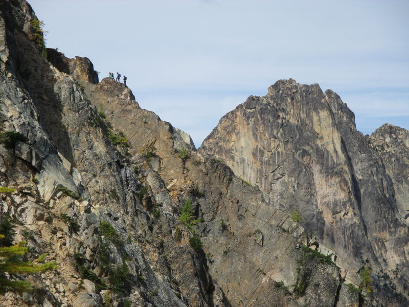 Josh Kling, Erik Leidecker, and Paul Koubeck on House Buttress, Poster Peak, with the Early Winter Spires in the background.