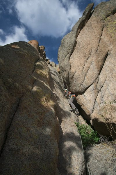 Alex fighting the good fight (wrong shoulder in, IMO). The most fun I've ever had on a squeeze chimney.