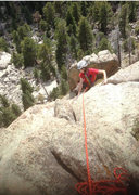 Roiann Baird, Batman Pinnacle, Batman and Robin route, Lumpy Ridge, CO. Pitch 2. <br /> <br />Photo by Peter Lev.
