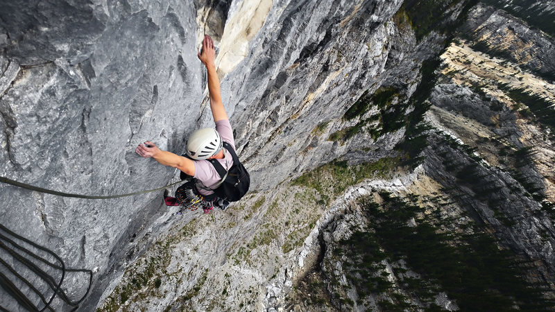 Finishing the 4th pitch (5.11b) on Tall Storey
