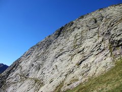 Dent d' Orlu East Face. Climbers can be seen on 2nd stance of Tapas des Dalles (V+) <br />