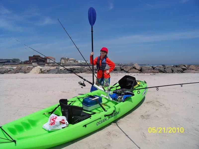 Zachary and me getting ready to launch our Kayak at the Jersey Shore to snag bunker and catch stripped bass. This Malibu XL2 kayak is the Cadillac of kayaks. It's fast and stable and get thru the surf without a problem. Note the front seat is turned to face me.