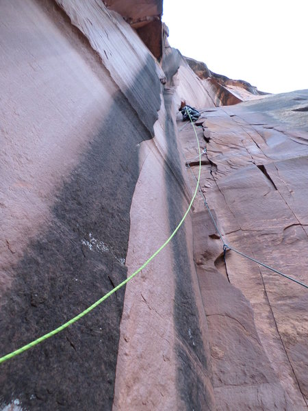 First ascent action with Tim Foulkes on the High Country Elevator, one of the best routes at the Dove Creek Wall.