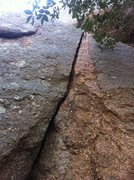 Rock Climbing Photo: base of the climb with the tree hugging in close o...
