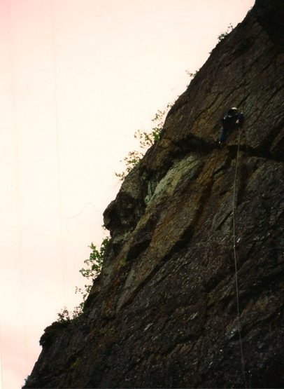 Dan Kryger on an early ascent of Sparklehorse (5.10a) on the Kiliak Wall. (June 2002)