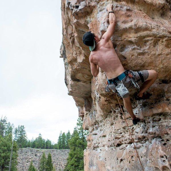 Pumping out on the crux on a beautiful day in the pines!