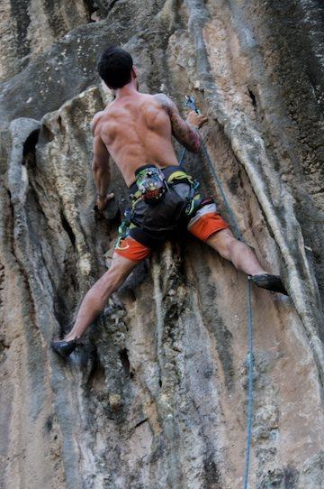 Elvis stemming the tufas on Tufa Two 5.12a, Iguana Wall