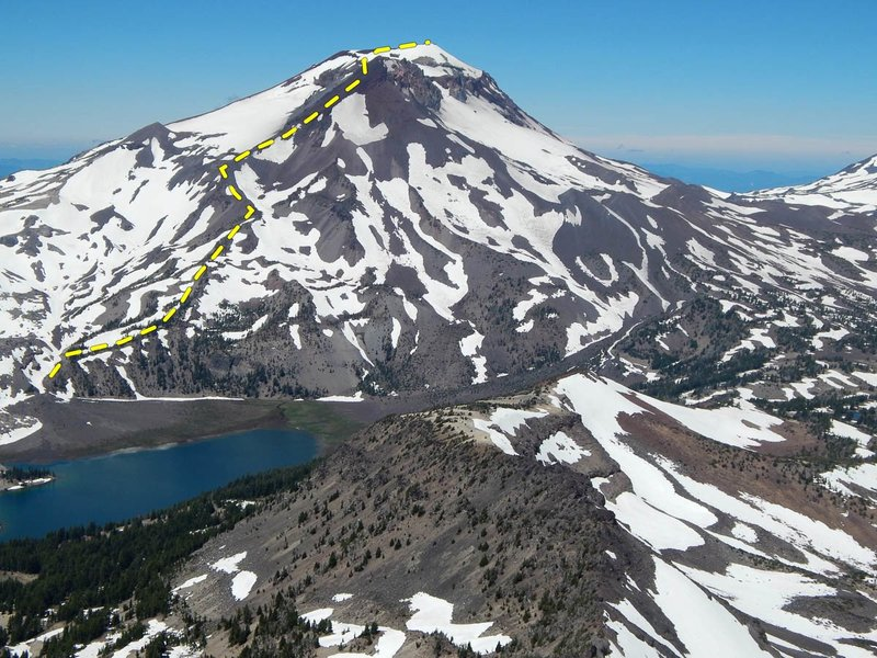 The route follows the prominent ridge line above Green Lakes to the sub-summit Hodge Crest, which appears as a prominent black pyramid of screw in this photo, and onwards to the true summit from there.